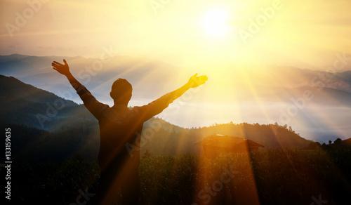 Fotografie, Obraz  Man thanks God on  mountain.