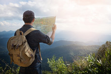 Young Man Traveler With Map Ba...