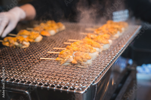 Fotografie, Obraz  Scallop and sea eggs skewer grill