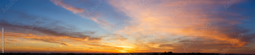 Fototapeta Beautiful sunset sky with amazing colorful clouds against deep blue