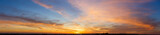 Beautiful sunset sky with amazing colorful clouds against deep blue