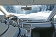 car interior with driver and winter road