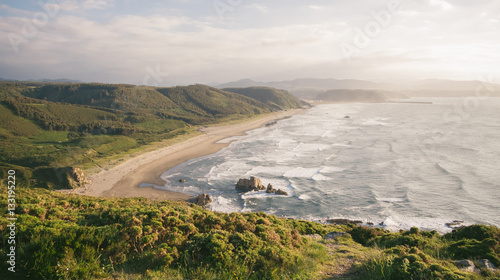 View of Bayas beach in a sunny day, in the coast of Bayas, Asturias, on Spain. It is the longest beach in all asturian coast.