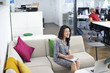 Young professional asian woman in an office break out area