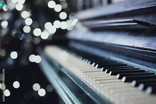Fotografie, Obraz  The old black piano. close-up of keys. Beautiful blur