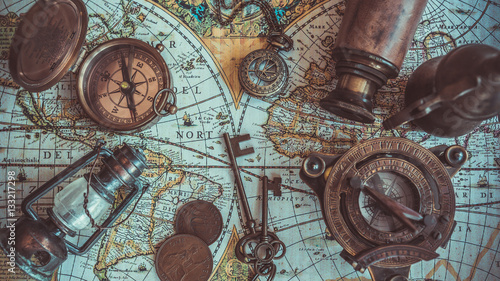Keuken foto achterwand Schip Retro brass compass with cover lid on old world map top view. (vintage style)