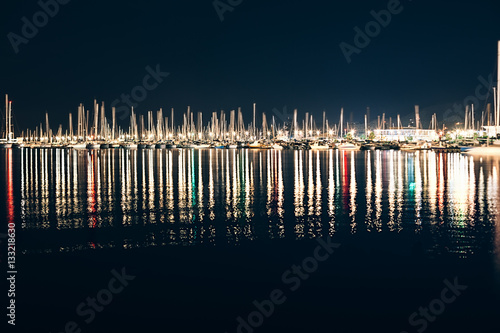 Obraz na plátně Yachts and boats in marina of La Spezia at night with reflection