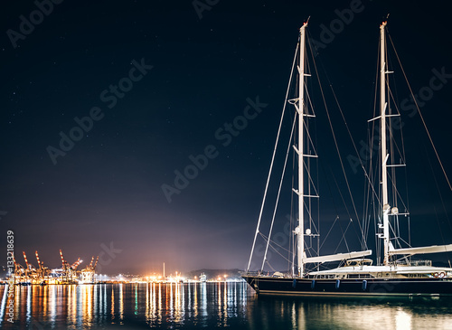 Fototapeta Luxury yacht in La Spezia at night with reflection in water