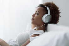 Woman Relaxing And Listening T...