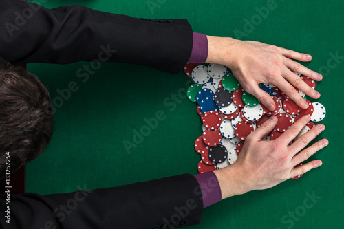 top view of poker player hands on gambling table плакат