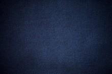 Blurry Background Of Blue Denim Jeans Texture.