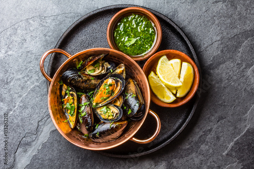 Shellfish Mussels in copper bowl, lemon, herbs sauce. Canvas Print