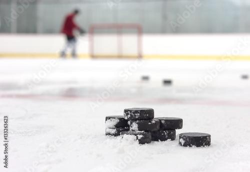 Plakat Gracz w hokeja z krążkami