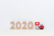 Miniature suitcase , National flag and 2020 on white background