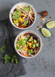 Mexican chicken tortilla soup with corn, beans and avocado. Delicious lunch, top view