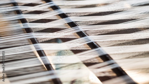 Fotografiet  Closeup, abstract weave silk pattern