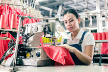 Chinese Seamstress Working In Textile Factory