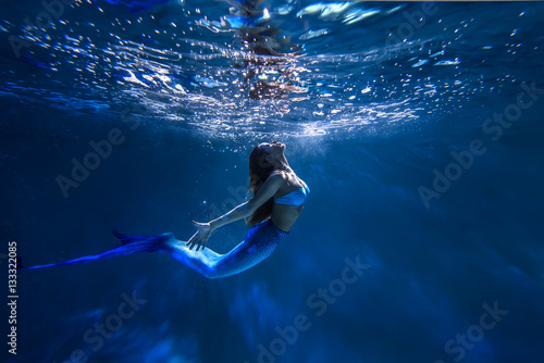 Freediver girl with the mermaid tale