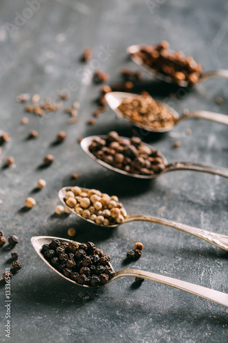 Foto op Canvas Kruiderij Spices on spoons