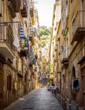Fototapeta Uliczki - Narrow street in old town of Naples city in Italy