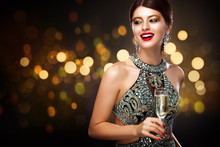 Woman In Evening Dress With Champagne Glasses - St Valentine's Day Celebration. New Year And Chrismtas