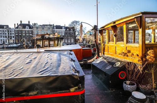 In de dag Illustratie Parijs AMSTERDAM, NETHERLANDS - JANUARY 09, 2017: Boats on water in beautiful evening sun set. January 09, 2017 in Amsterdam - Netherland.