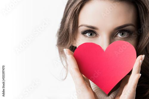 Fotografie, Obraz  Girl holding paper heart