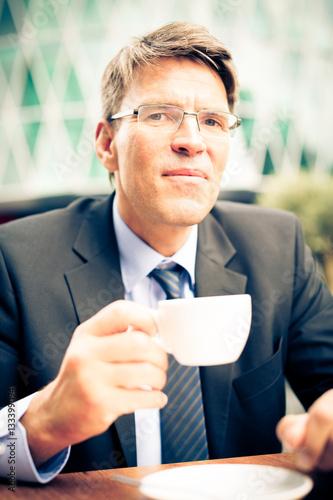 Photo  Businessman Having Coffee