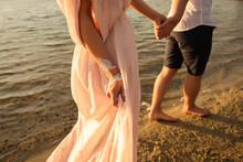 Sea Travel Concept, Indian Couple Walking On Beach Of Sea Or Ocean At Their Honeymoon Adventure