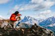 canvas print picture - Hund und Mann in den Bergen