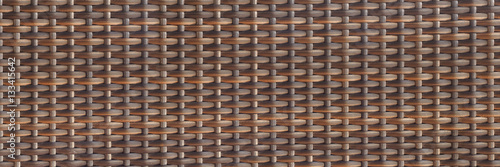 Fotografiet  horizontal woven rattan texture for pattern and background
