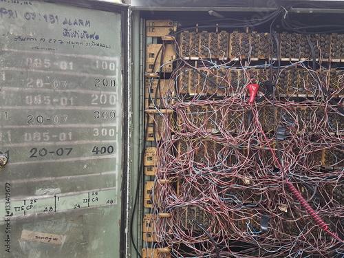 old telephone wiring cabinet with door open