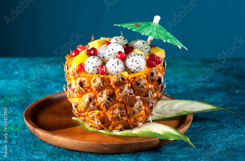 Photo  Exotic fruit salad. Dragon fruit, pineapple and pomegranate