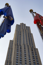 Looming 30 Rockefeller Center Building Flanked By Flags