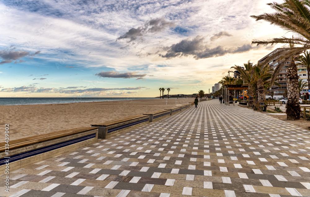 Fototapety, obrazy: Long tile boardwalk in serene Mediterranean beach scene
