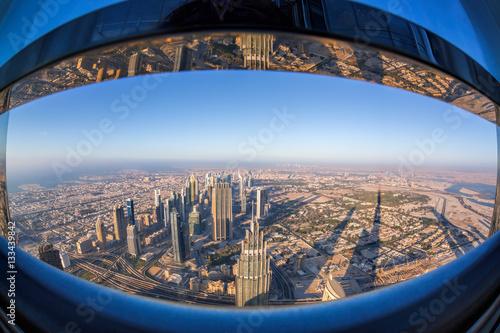 Photo  Dubai skyline with futuristic architecture by fisheye, United Arab Emirates