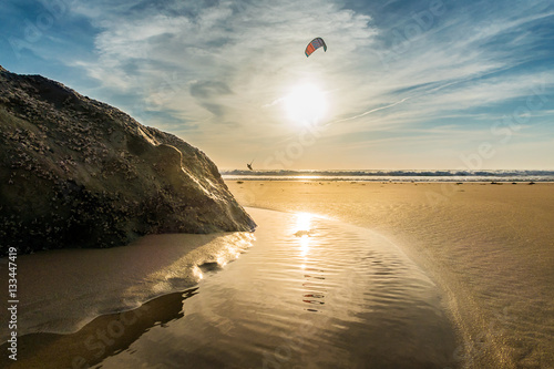 Sunset on the beach of Tarifa, with solitary kiter
