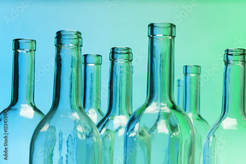 Fotografia, Obraz  Empty glass bottles with close-up focus to necks