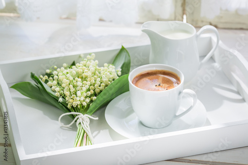 Poster Muguet de mai Delicious espresso with flowers on white table