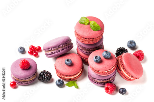 Poster Macarons Closeup of fresh macaroons with fruits on white background