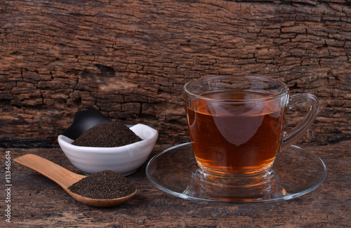 Foto op Canvas Alcohol cup of tea on vintage wooden background