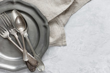 Silverware On A Pewter Plate
