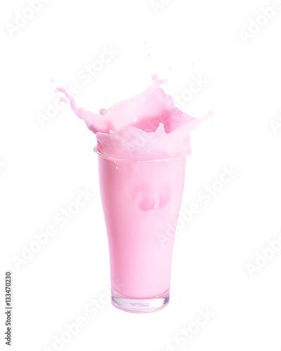 Foto op Aluminium Milkshake Splash of strawberry milk from the glass on isolated white background.