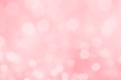 Abstract blurred pink bokeh lights background.