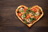Heart shaped pizza with chicken and mushrooms on dark wooden vintage background. - 133489295