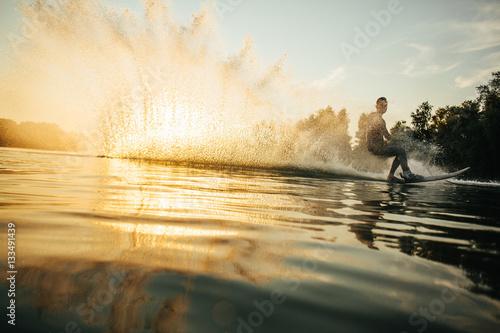 Vászonkép Man wakeboarding on a lake