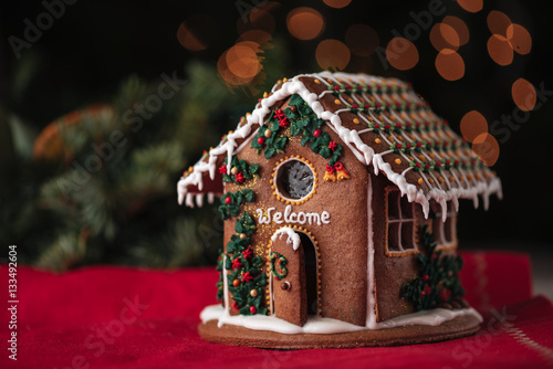 Foto op Canvas Kerstmis Christmas gingerbread house decorated inscription Welcome