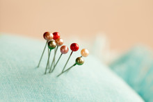 Colorful Pearlized Pins And Textile Material. Macro View Extremely Soft Focus