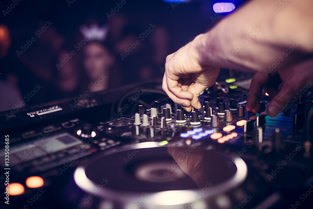 Fototapety, obrazy: DJ plays music on his Pioneer deck in party