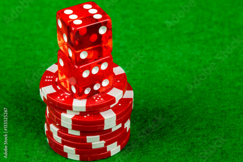 фотография  Gambling dice and satck of betting chips